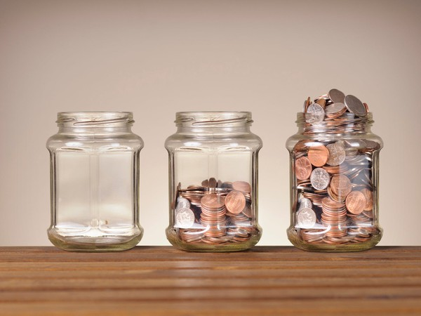 Dividend coin concept GETTY