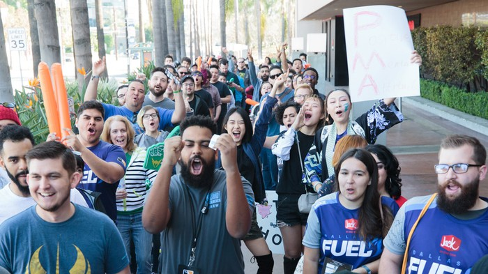 Excited fans waiting in line to watch Overwatch League matches.