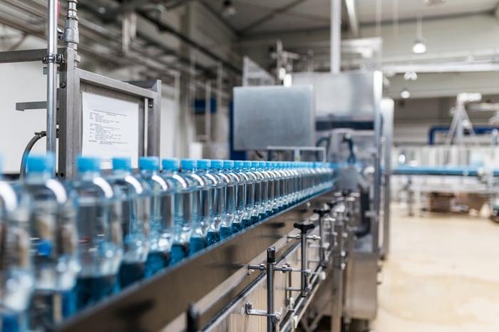A beverage-bottling plant assembly line