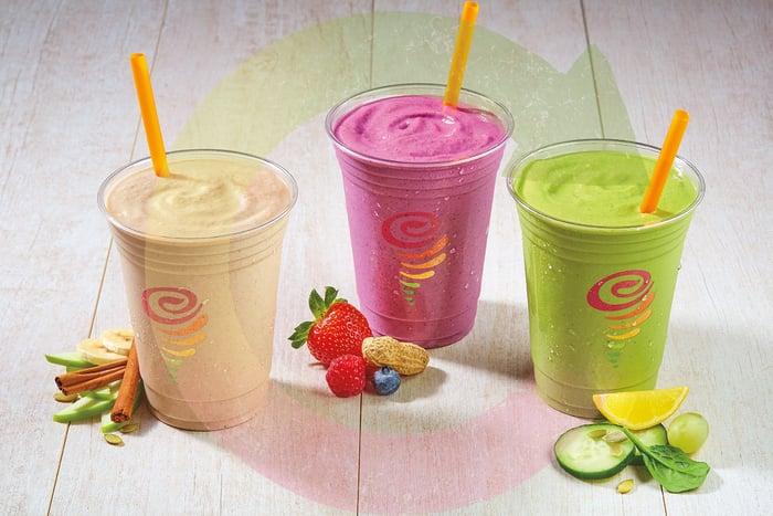 Three Jamba Juice fruit smoothies.