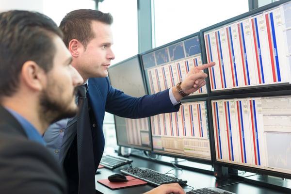 Stock traders looking at screens