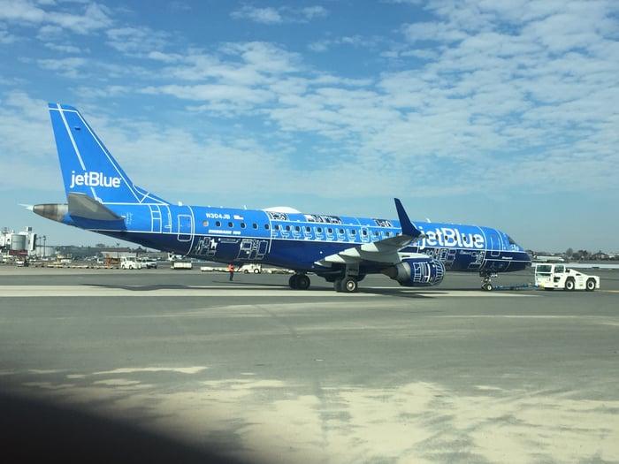 A JetBlue Airways E190 jet on the tarmac