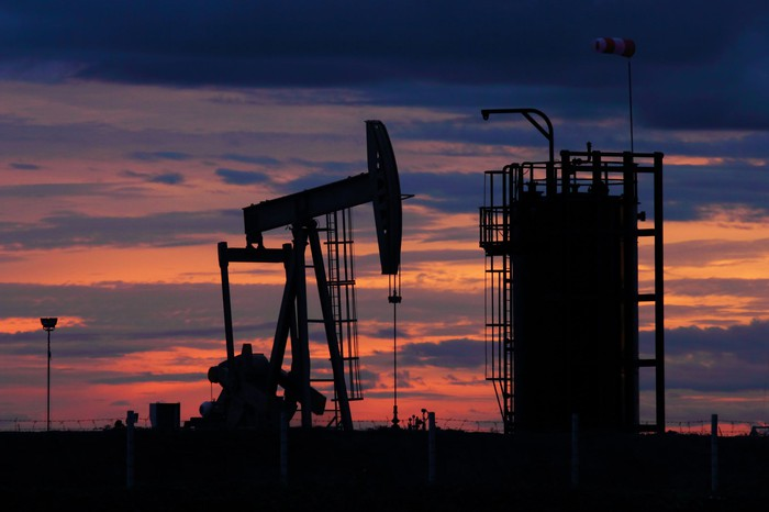 An oil pump at dusk.