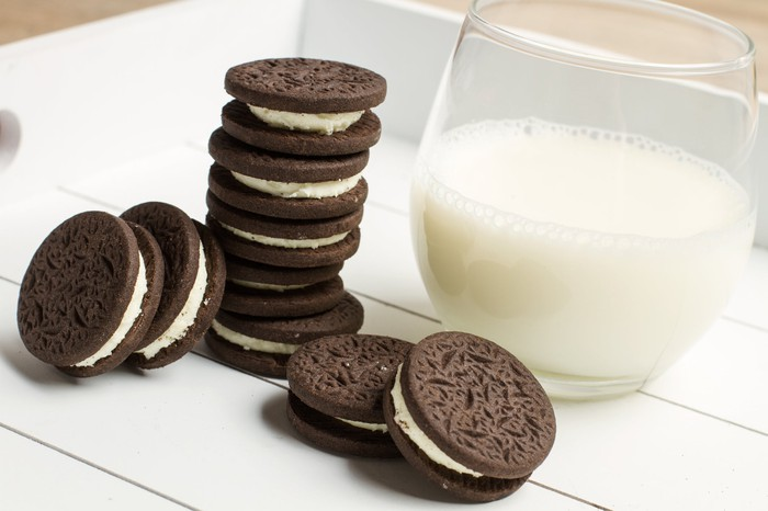 Creme-filled chocolate cookie and glass of milk
