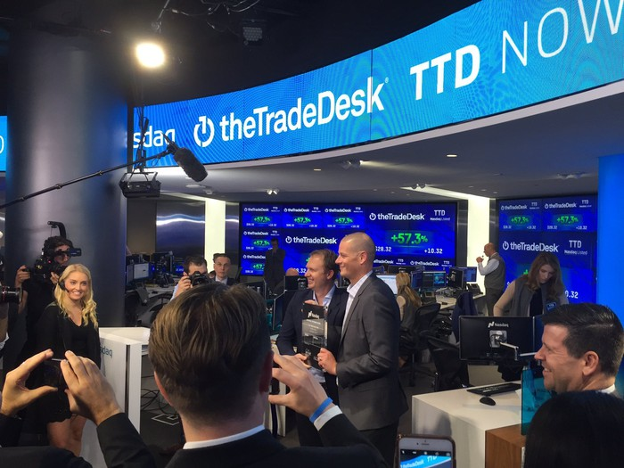 Representatives from The Trade Desk at its Nasdaq-listed IPO two years ago under a sign that says The Trade Desk..