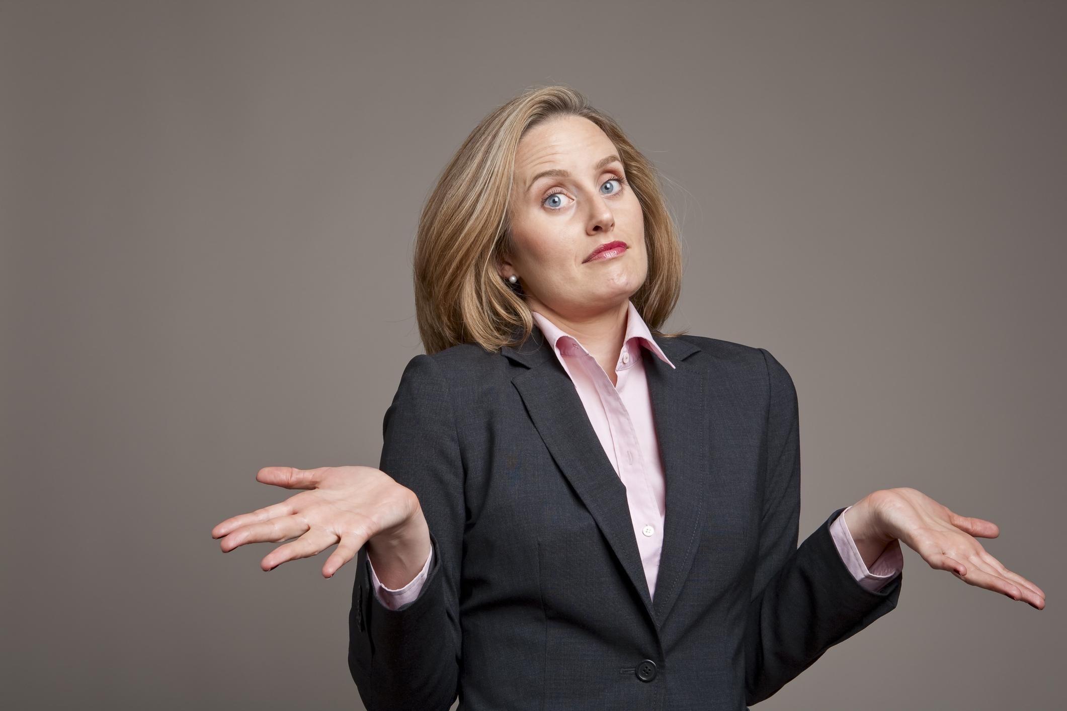 Shrugging businesswoman.