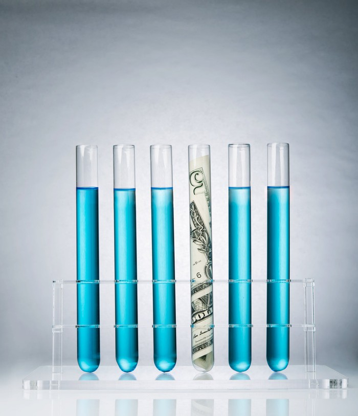 Test tubes with one containing cash