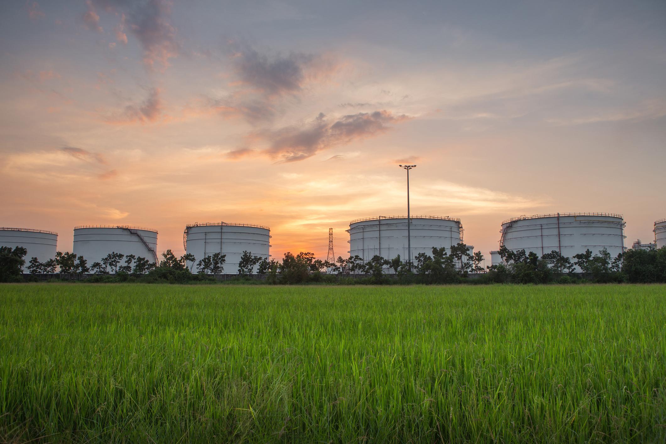 Oil tanks in a field