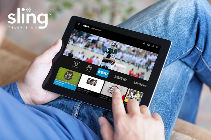 A person using Sling TV on a tablet