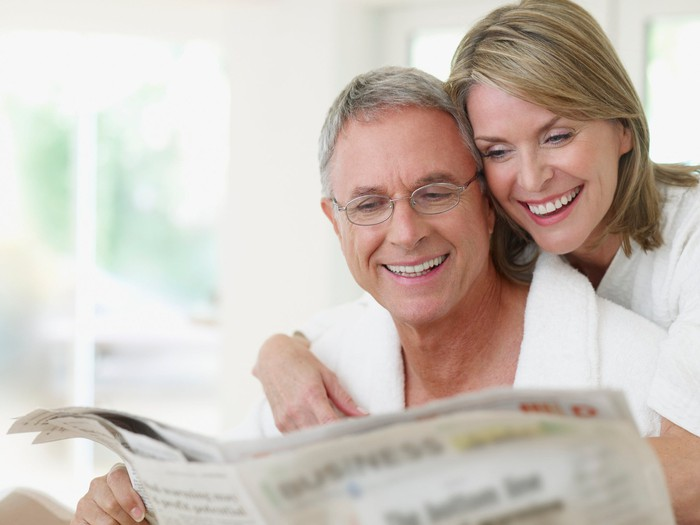Older couple reading a newspaper