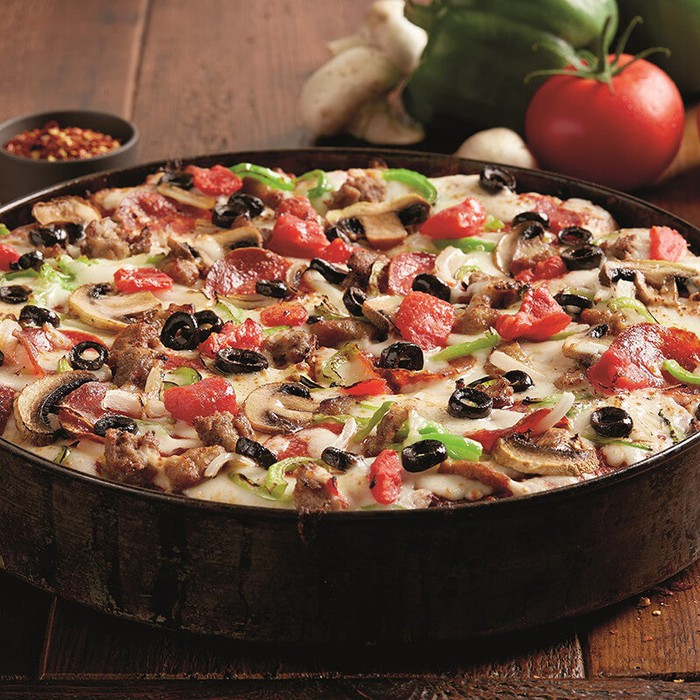 A pan pizza with several different toppings
