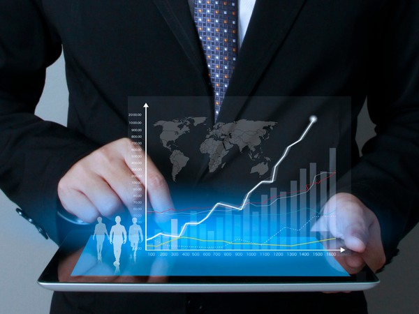 Business man touching screen with chart coming off of it