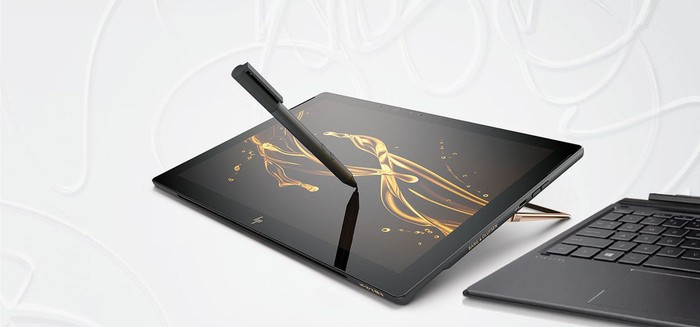 A pen hovers over the screen of HP's Spectre x2.