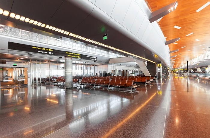 Modern airport seating area with warm architectural accents.