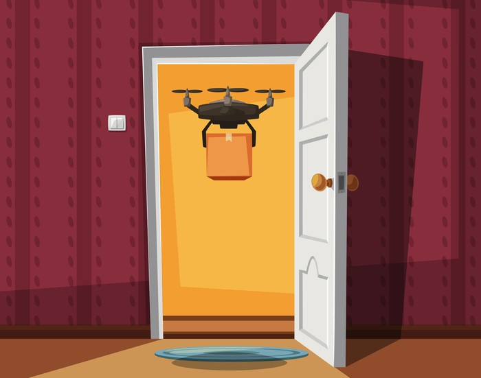 Drone delivering package to front door