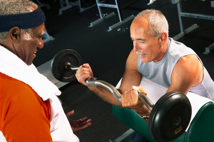 Two men exercising at a gym