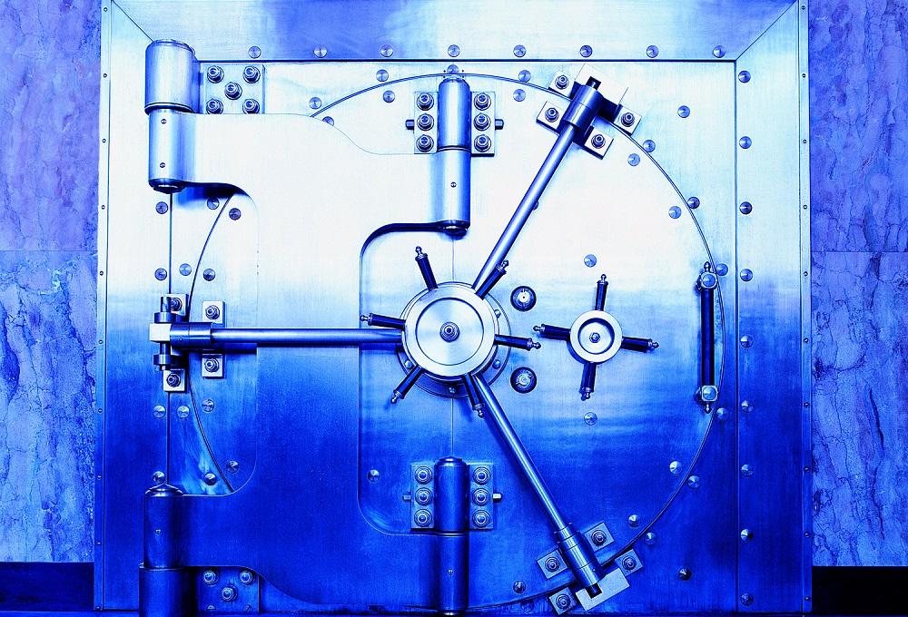 Large steel vault door with blue tones