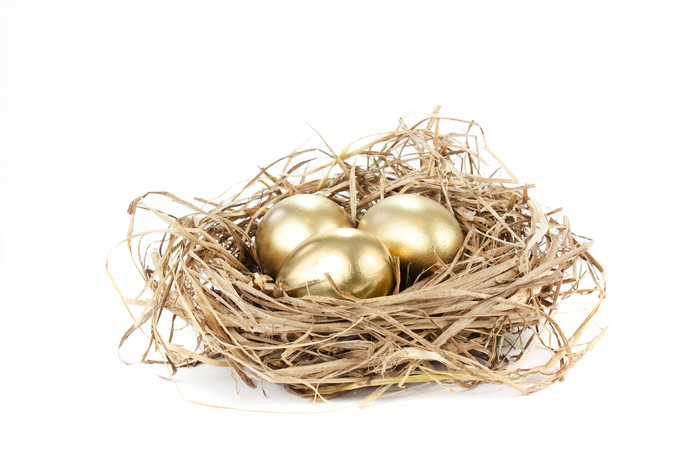 Three golden eggs in a nest.