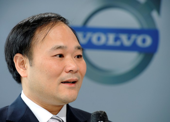 Li is shown standing in front of a backdrop with the Volvo Cars logo.