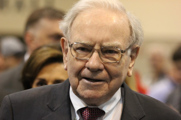 Berkshire Hathaway CEO Warren Buffett wearing a suit and tie at an event.