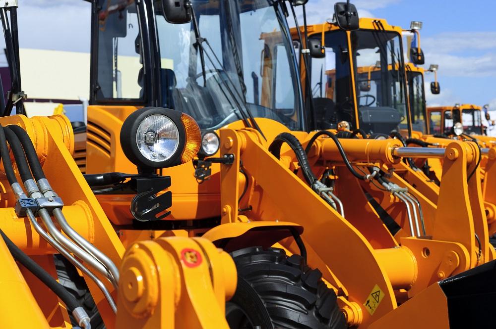Orange tractors with hydraulic lines.