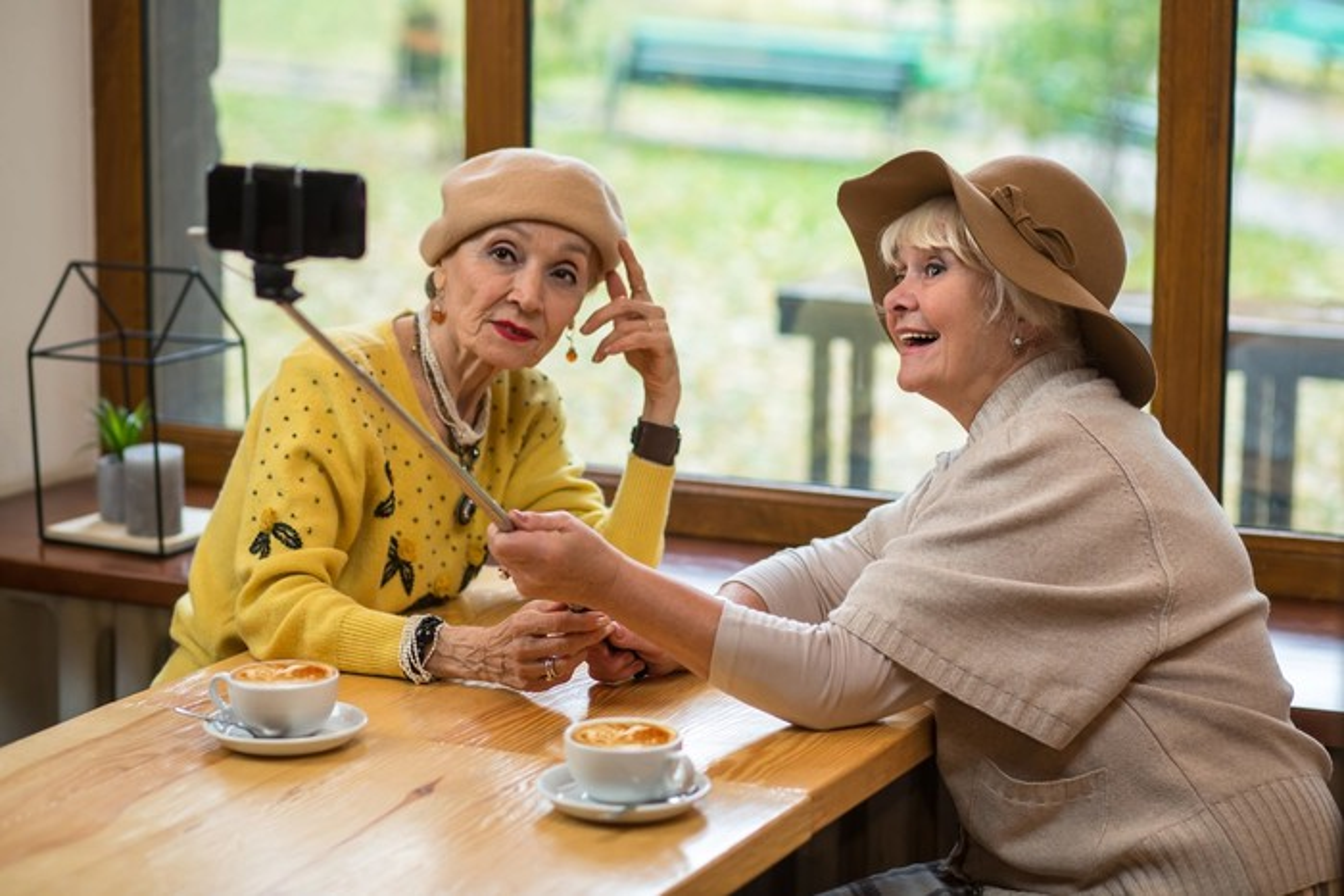 Two elderly women taking a selfie.