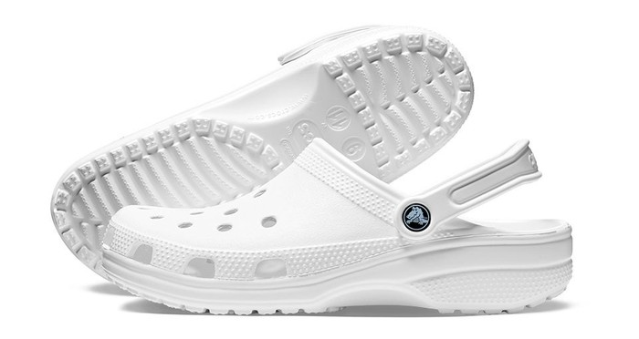 A pair of white Crocs clogs.