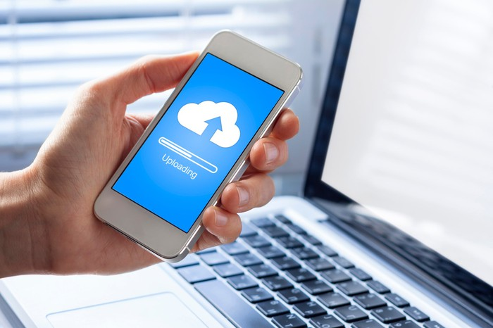 A smartphone uploading data to cloud storage