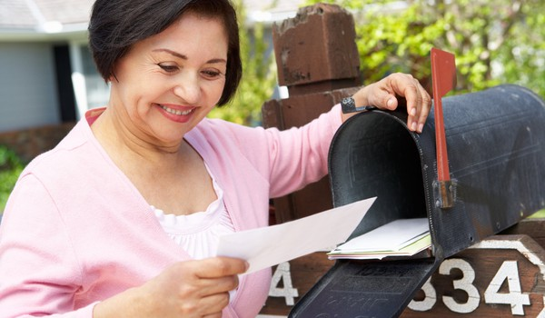 Getty Retiree Opening Mailbox