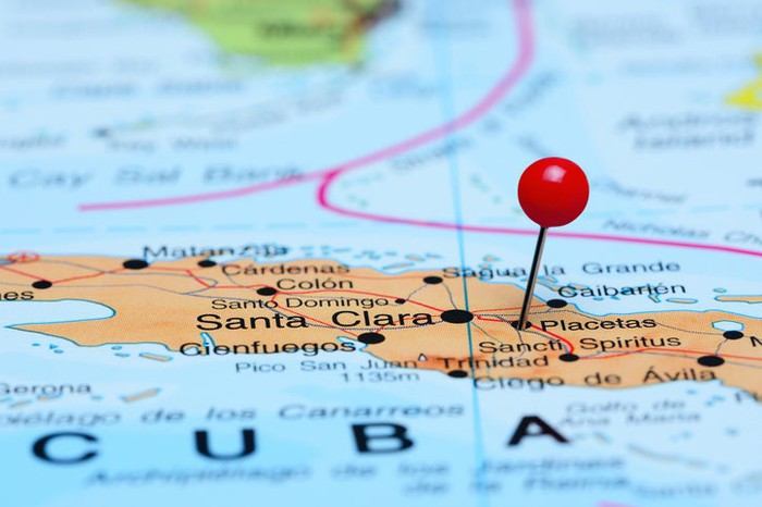 Cuba shown on a map with a red pin sticking in the country's location.