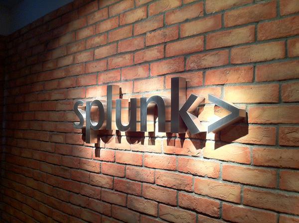 Splunk logo on a brick wall