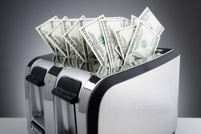 A toaster burning cash.