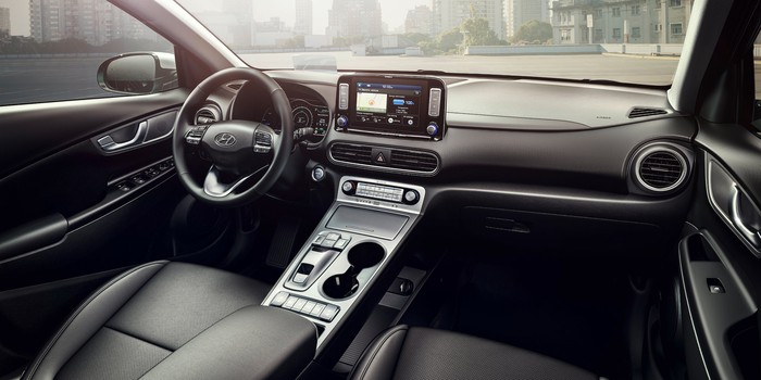The dashboard and front seats of the Hyundai Kona Electric.