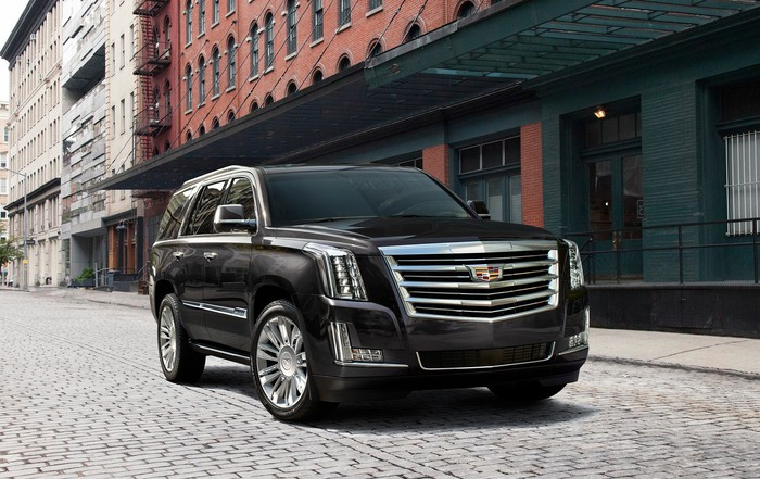 A Black Cadillac Escalade Large Suv Parked On New York City Street