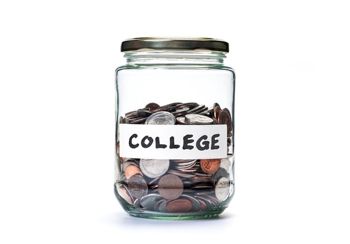 "Glass jar of coins, labeled ""College"""