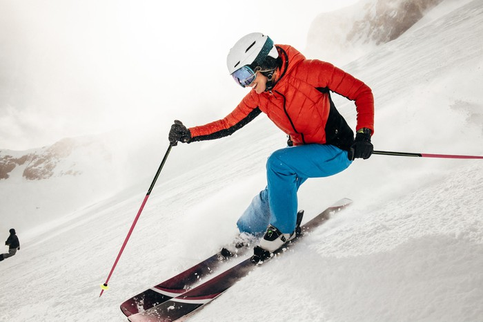 A person skiing with an Apple Watch on their wrist.