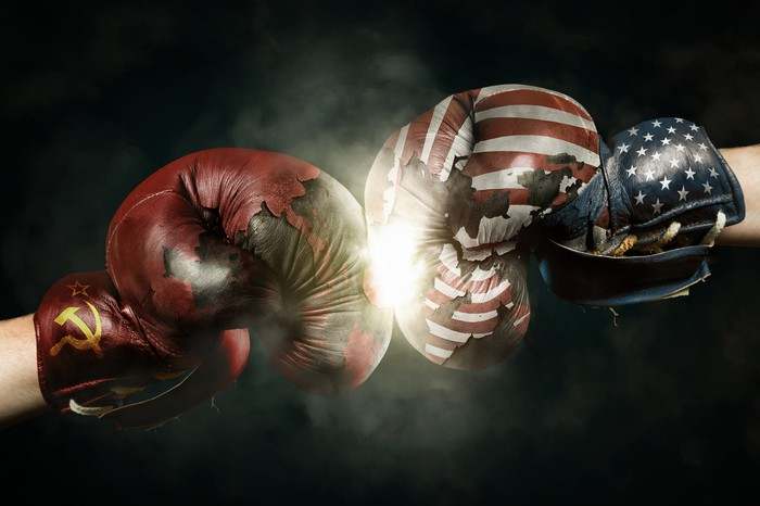 Hands with boxing gloves representing Russia and the U.S.