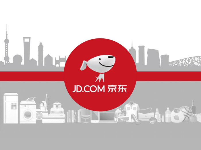 JD.com's cartoon-dog mascot overlaid on a cartoonish city skyline on the top half and a lineup of products like household appliances, books, and clothing on the bottom half of the background.