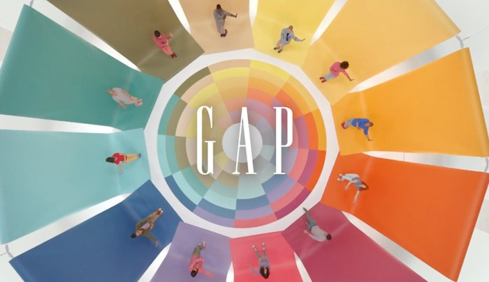Gap logo with 12 people on different colored segments arranged in a circle.