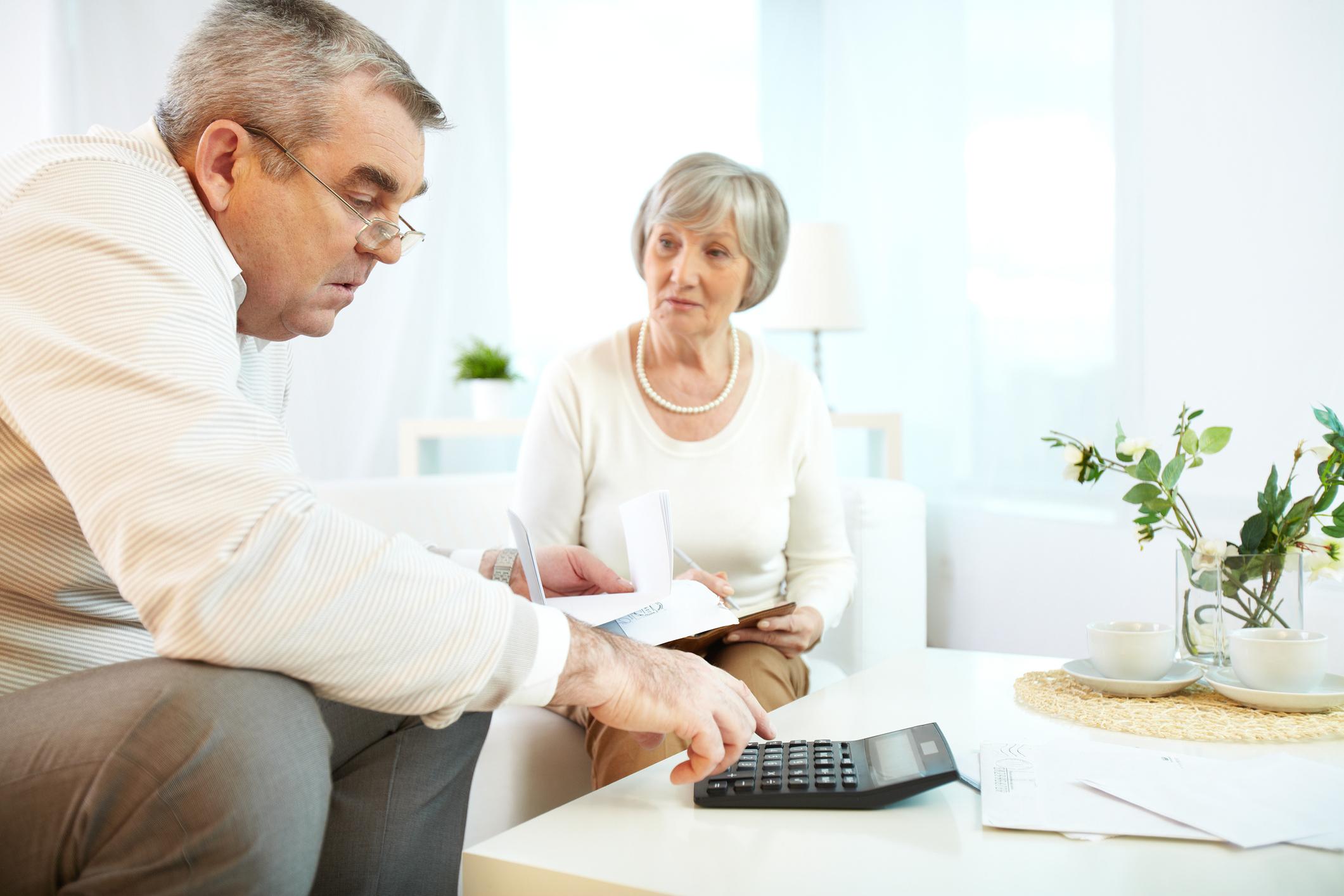 An senior couple reviewing their finances,