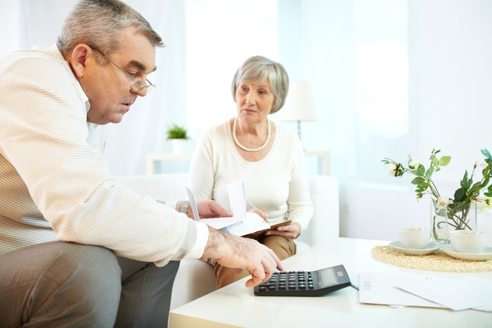 An senior couple reviewing their finances,