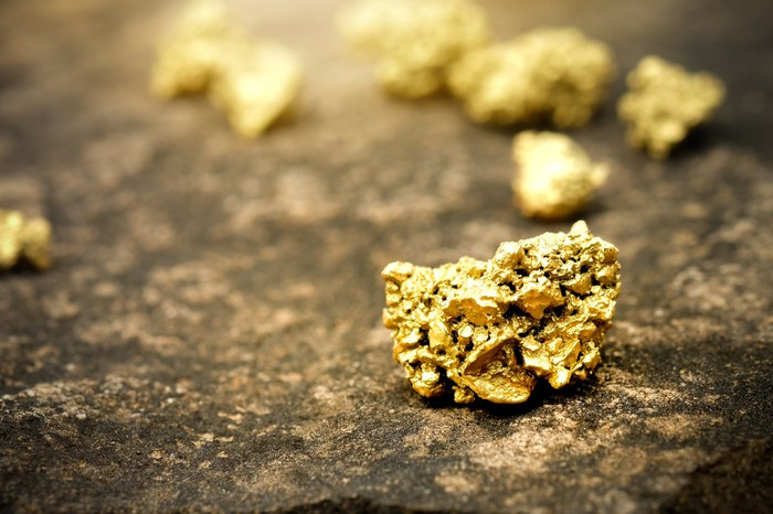 Gold ore on a stone floor.