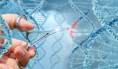Person  with scissors cutting a DNA Strand -- GettyImages-691562550