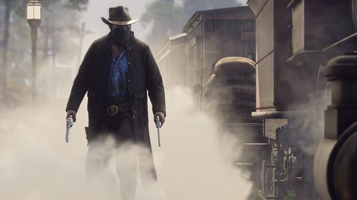 A character with a bandanna covering his face wearing a Western hat holds two pistols in Take-Two's upcoming game Red Dead Redemption 2.