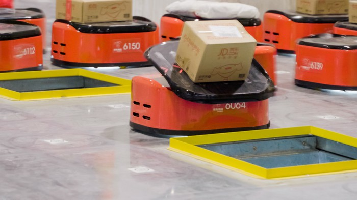 A robot sorts a cardboard package  at JD's fully automated warehouse.
