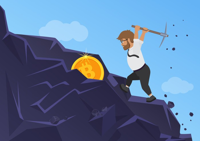 An illustration of a man mining a bitcoin from rock.