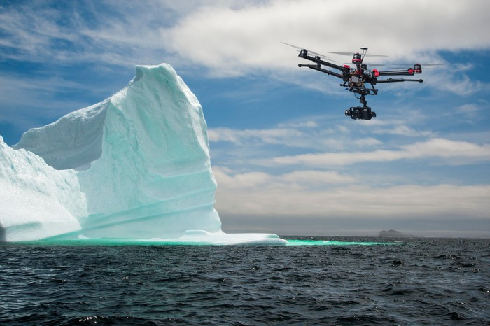 Drone flying near iceberg