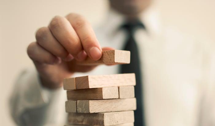 A man building blocks