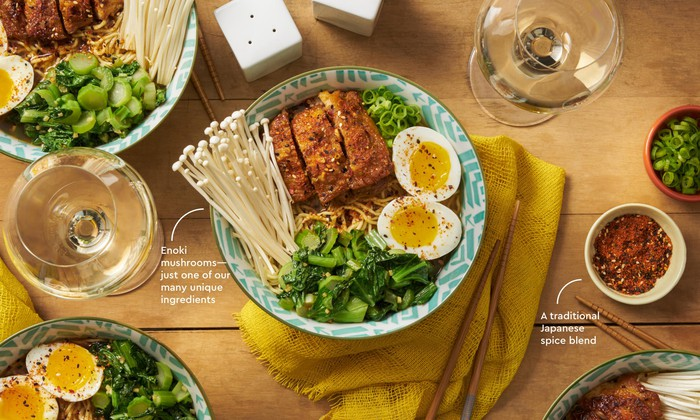 A finished Blue Apron meal in bowls and plates on a table