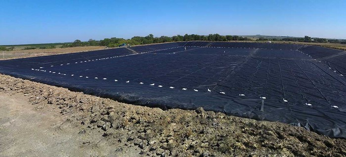 Black film covering the ground from Raven Industries' Engineered Films division